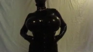 Sweet Mirra Doll putting on a sensual latex uniform