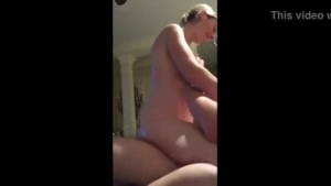 Busty blonde woman is fucking her lover in the bathroom after she sucked his hard cock
